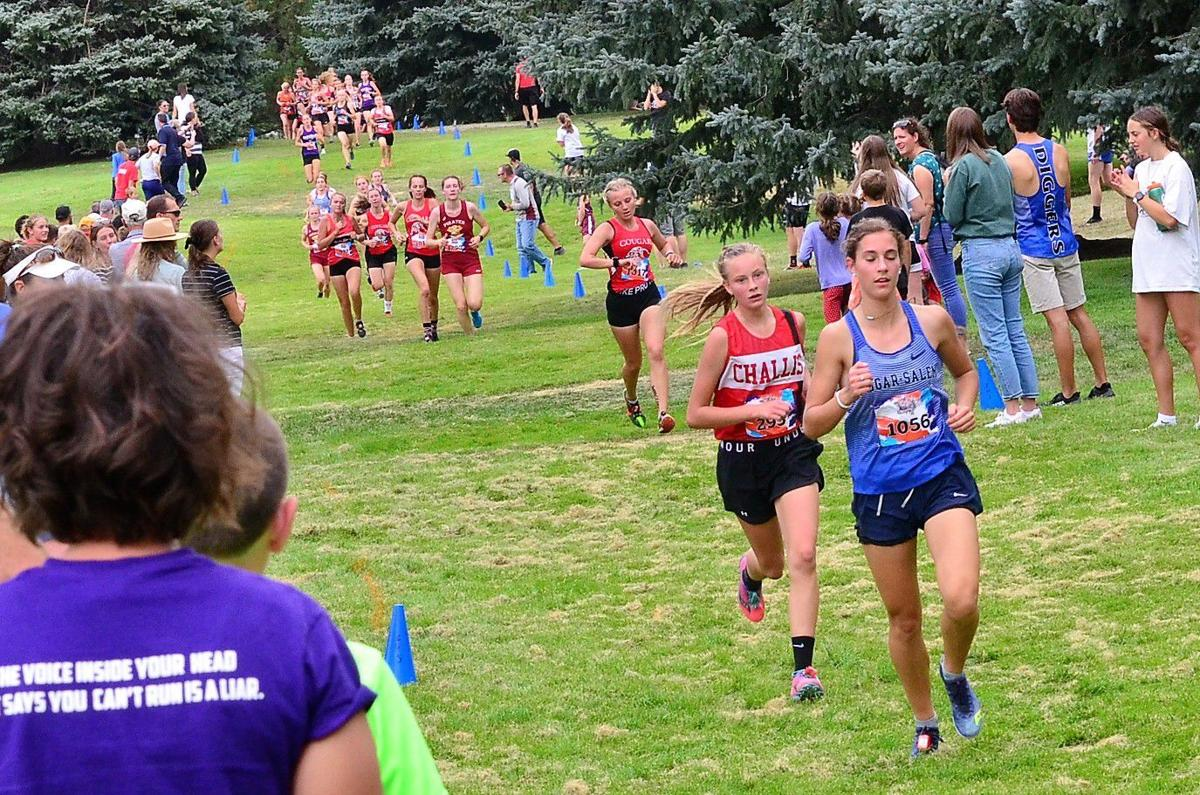 Sugar Salem's Jaresa Jackson runs ahead of Challis's Taylor Redick about halfway through the Tiger-Grizz Varsity B race.  Jackson won the race with Redick taking second.  South Fremont's girls team took second behind Soda Spring with Sugar Salem finishing in fifth place