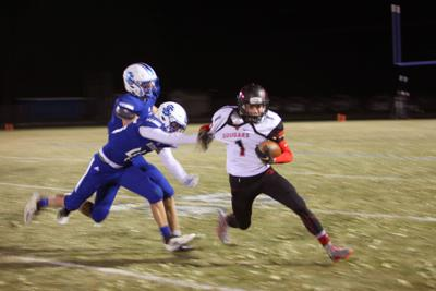 South Fremont's Dallin Orme tries to escape as Sugar-Salem's McKay Schulthies grabs ahold of his jersey.