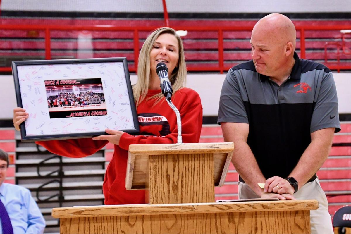 South Fremont's Chris Tucker accepts an award from South Fremont Booster Club President Kristy Hammond.