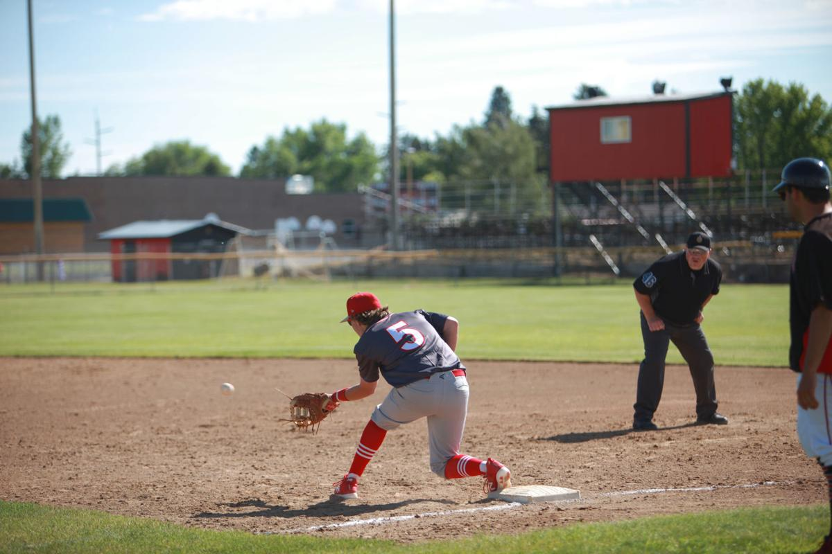 Madison's Marc Telford goes down to catch the ball and get a South Fremont runner out at first base.