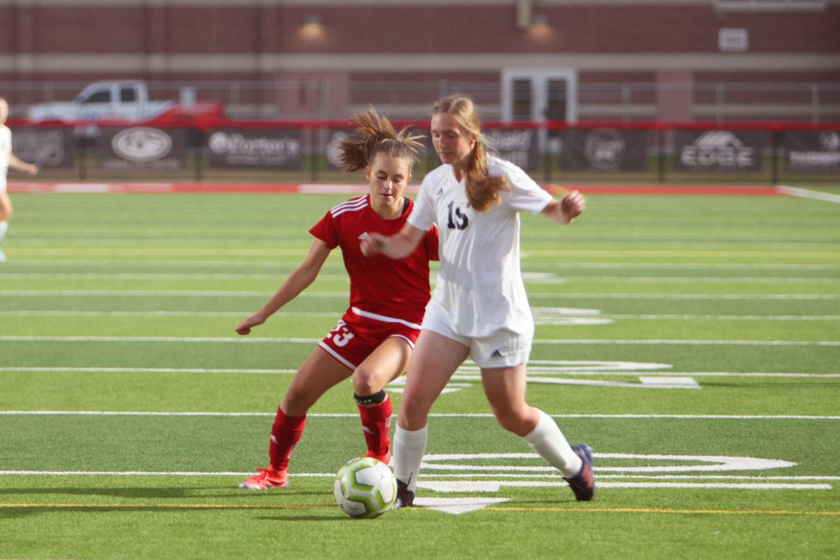 Madison's Evelyn O'Shaughnessy(23) sneaks behind a Rigby player.