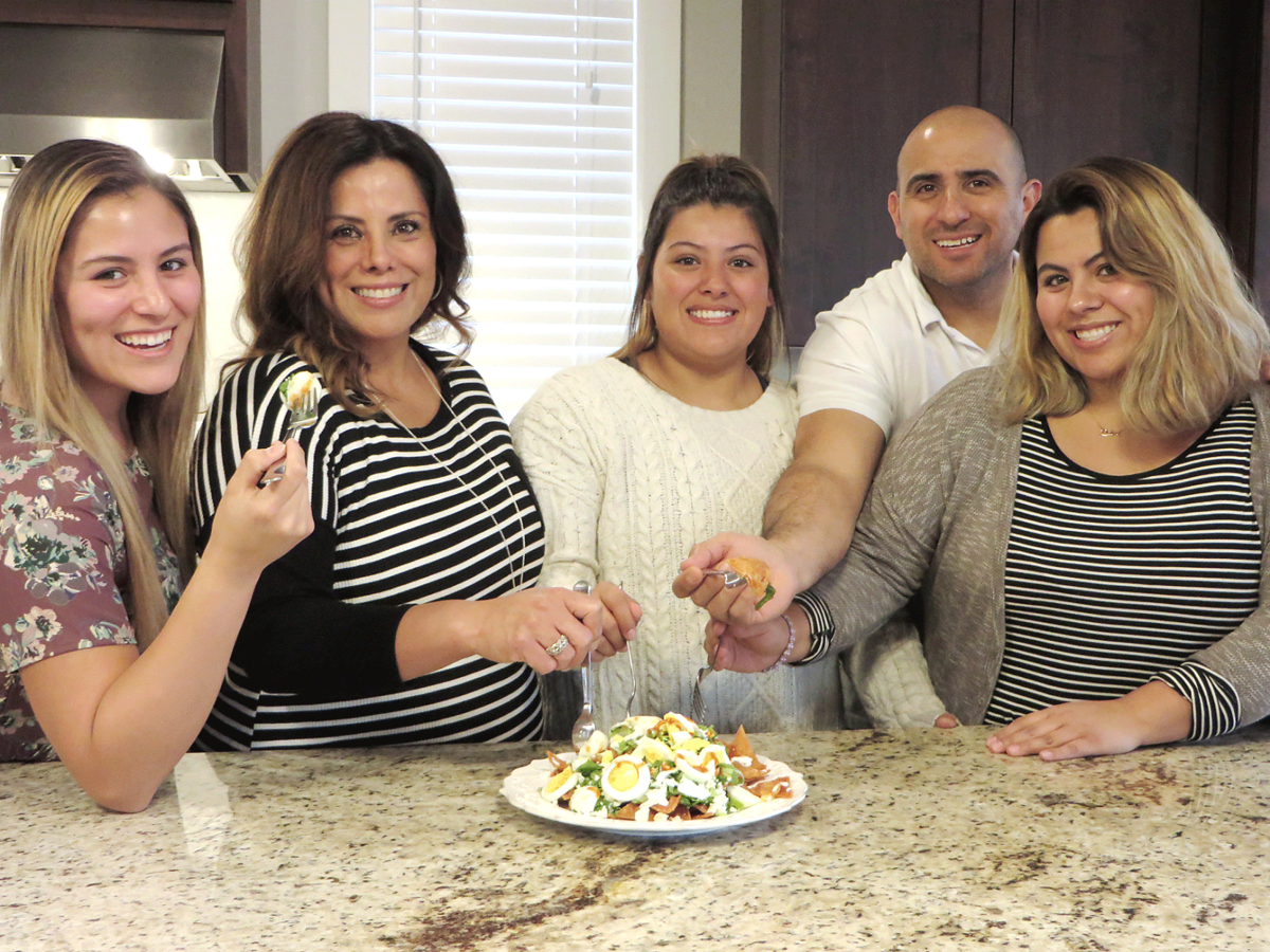 The Family Of Nick And Elvira Perez Dip Into A Favorite Mexican Dish That They Enjoy As Often Will Make It From Left Are Natalia