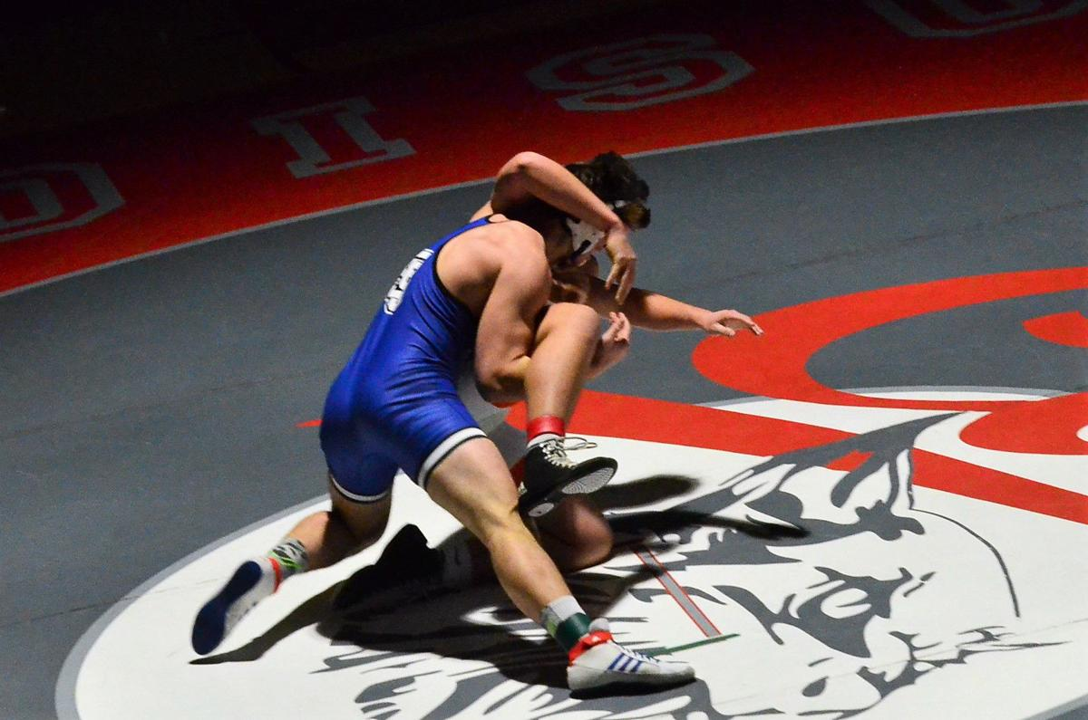 Sugar Salem's Kyler Dalling takes down Porter Wright of Jerome in overtime to win the gold medal at the Madison Invitational.