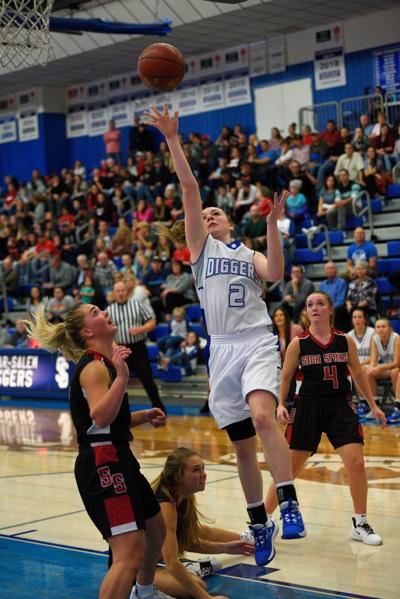 Sugar-Salem's Hailey Harris goes up for a layup over a of couple Soda Springs' players.