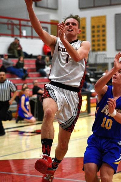 South Fremont's Dallin Orme goes up for a layup.