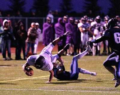 North Fremont's reaches for extra yards against West Jefferson.