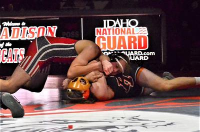 """Madison's Orion Stokes pins Idaho Fall's wrestler, Keman Longua with a """"barbed wire"""" combination Wednesday night in Rexburg."""
