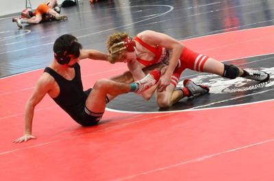 Madison's Noah Ingram takes down Highland's Emilio Velasquez in the third round of semi-final match on Wednesday to advance to the final match.  Ingram would lose the final 1-0 to Kayson Kenney from Idaho Falls.