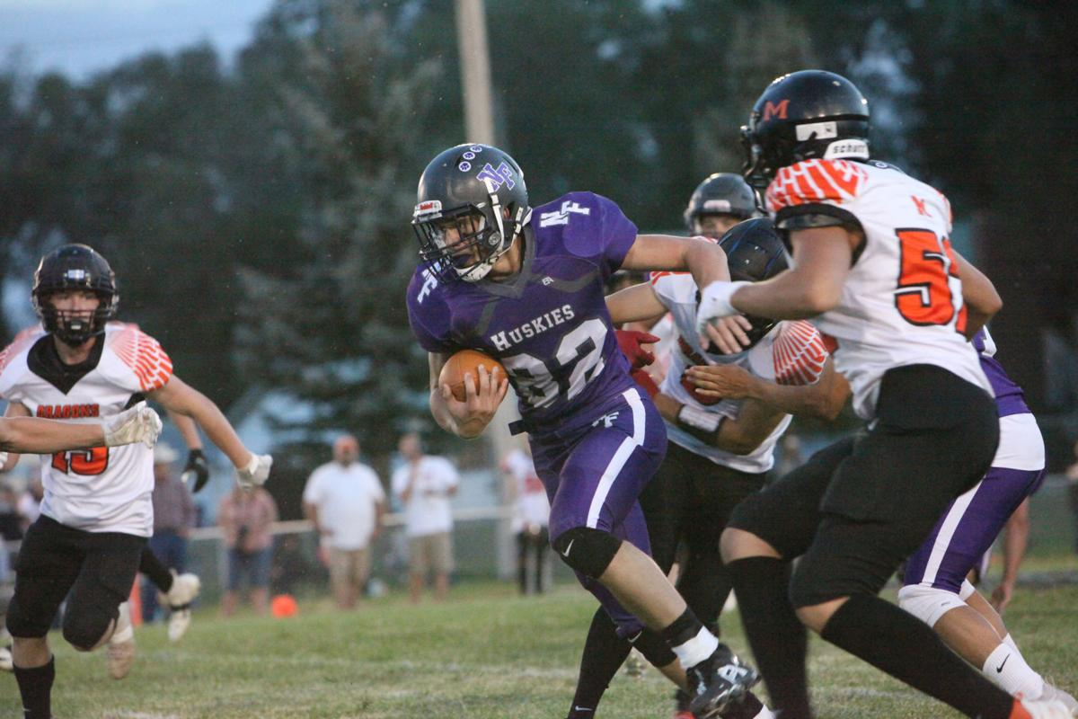 North Fremont's Hank Richardson runs through the defense.