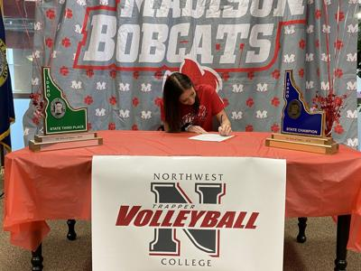 Madison's Bayley Petterson signs her letter of intent to play volleyball for Northwest College.