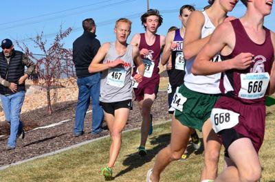 Madison's Ryan Stutz makes a move with 800 meters left in the state 5A race to move from 14th to a ninth place finish to help Madison take third place.