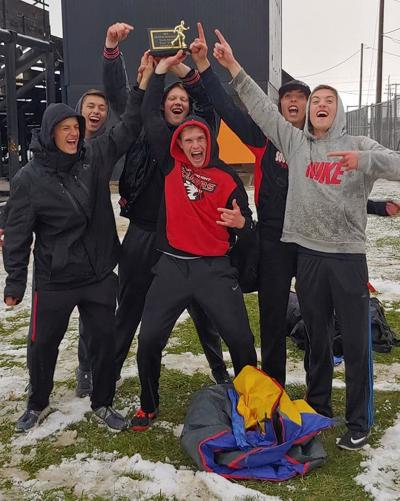 South Fremont's boys track team celebrates with their second place trophy after the Aberdeen Invitational.