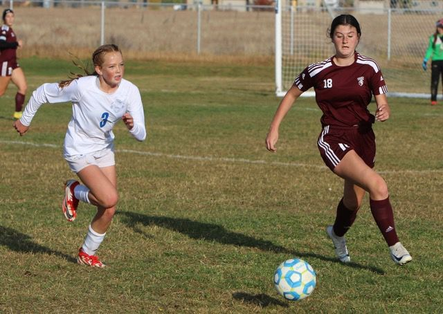 Sugar-Salem's Ava Rydalch sprints to the ball.