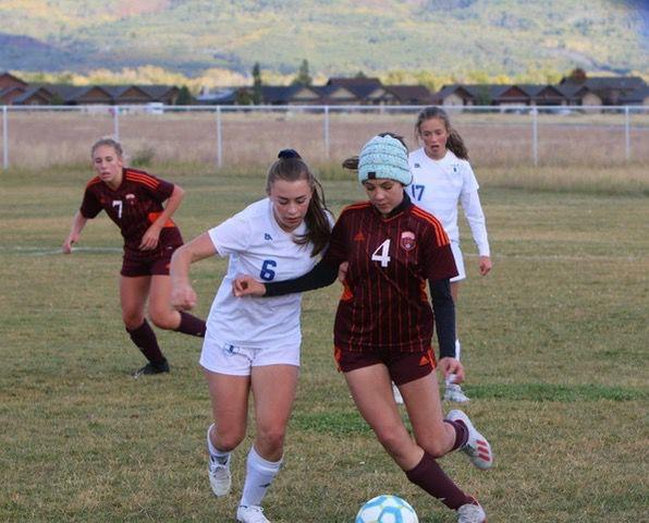 Sugar-Salem's Lily Parker battles a Teton player for the ball.