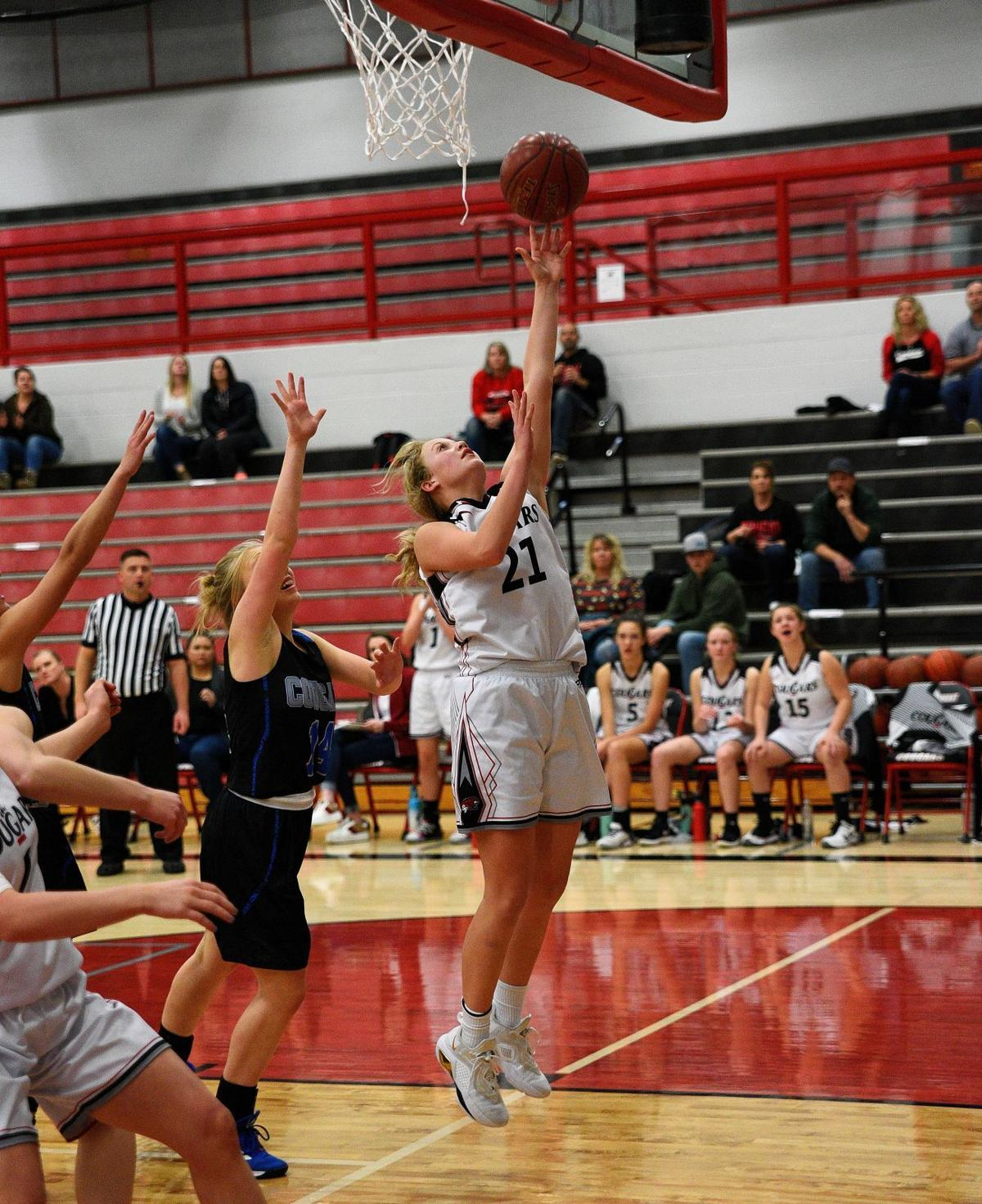 South Fremont's Berklee Yancey lays the ball up off the backboard.