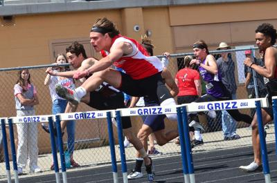 Madison's Cameron Porter clears the third hurdle in the 110's as he leads the pack in his 15.18 winning time at the Tiger-Grizz.