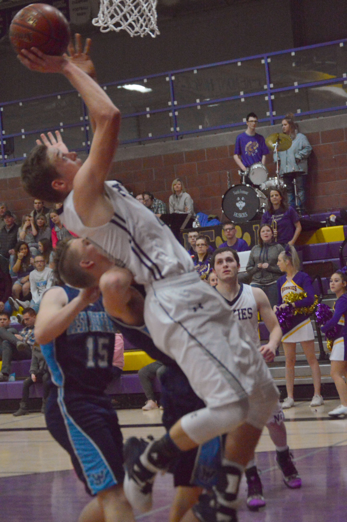 North Fremont's Garrett Hawkes leans back to get a shot at the bucket.