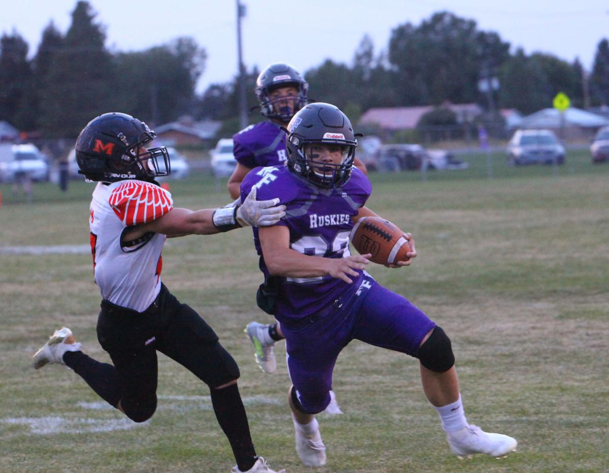 North Fremont's Carson Packer breaks a Malad tackle.