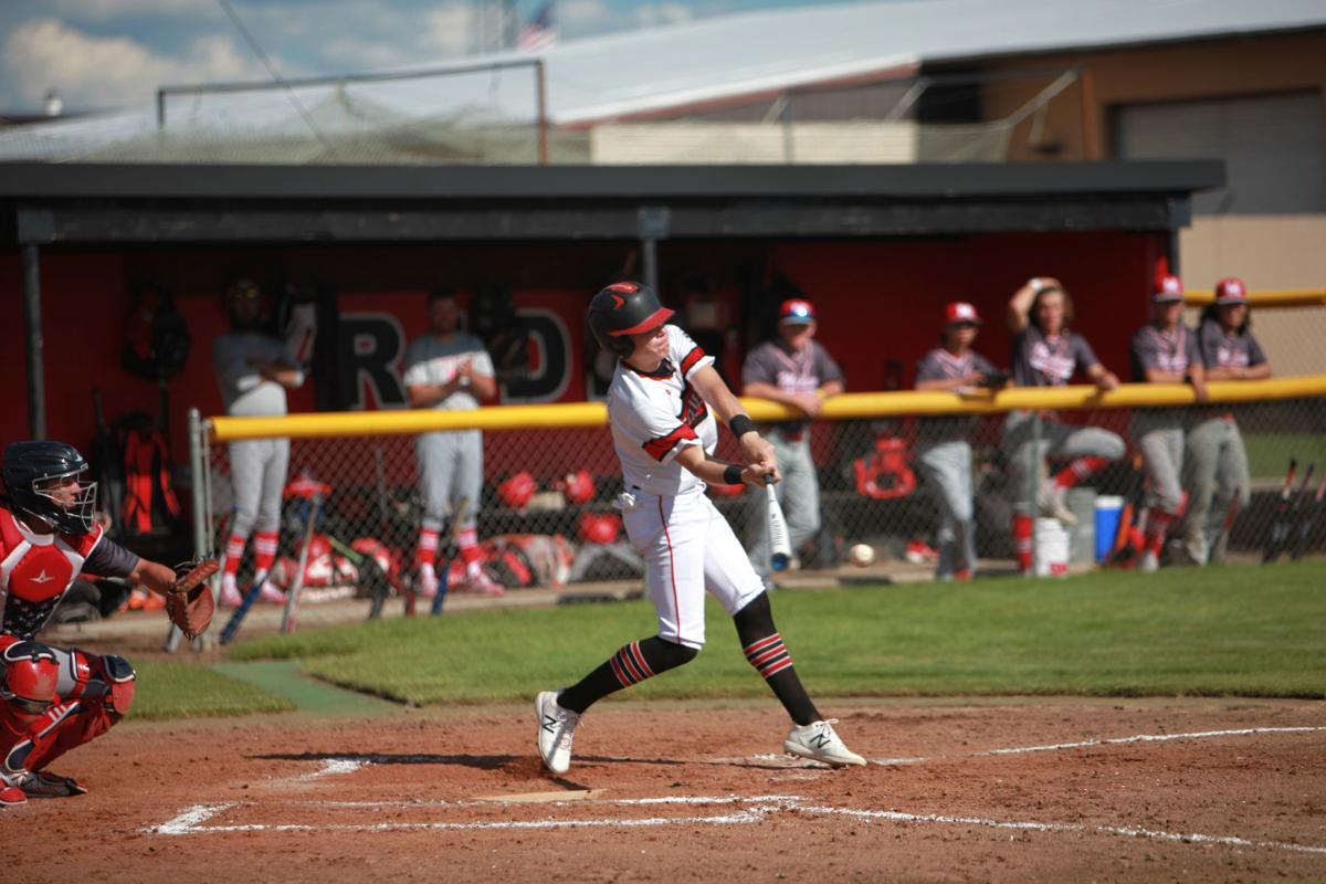 South Fremont's Kaimen Peebles strikes the baseball in the first of the Cougars two wins against Madison Friday.