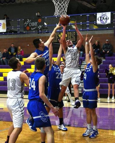 North Fremont's Luke Hill rises over the Sugar-Salem defense in the Huskies' win Wednesday.