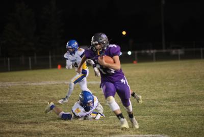 North Fremont quarterback Luke Hill heads up the sideline after dropping a Ririe defender.