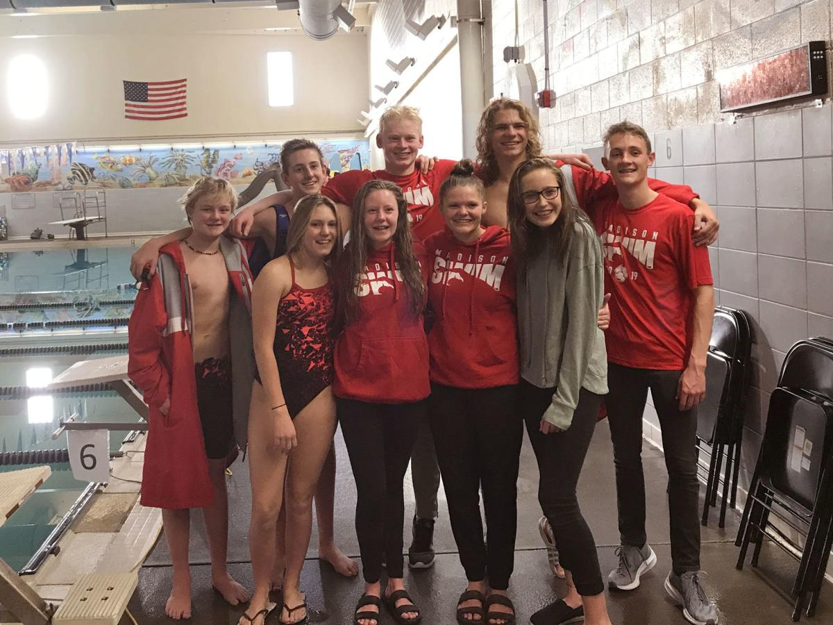 Madison's swim team gathers for a photo at their district meet.