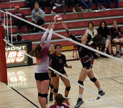 South Fremont middle blocker Aysiah Conger tips the ball over a Teton player's fingertips in the Lady Cougar's 3-2 win over Teton.