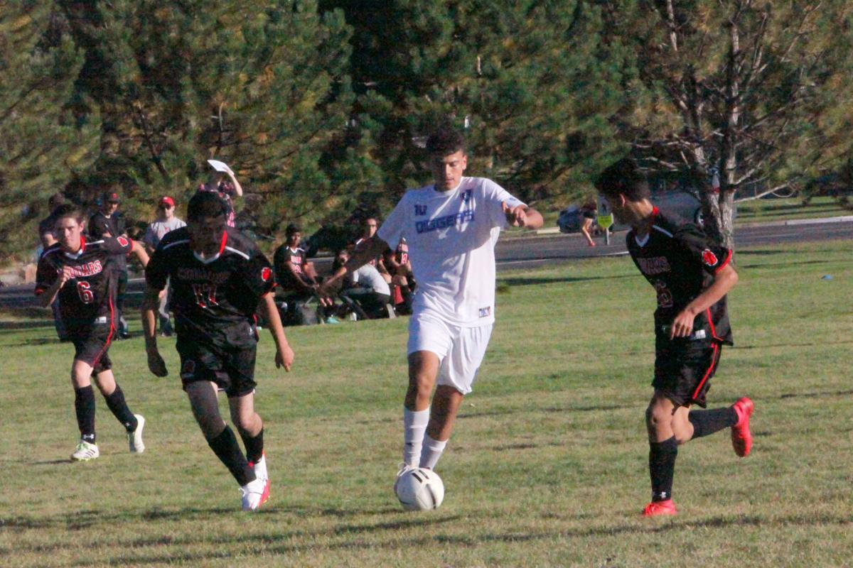 Sugar-Salem's Richardo Contreras splits South Fremont defenders in the Diggers' win Tuesday. Contreras scored a score record 8 goals in the game.
