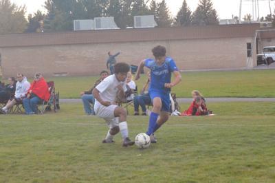 Sugar-Salem's Ricardo Contreras and a South Fremont defender fight for the ball.
