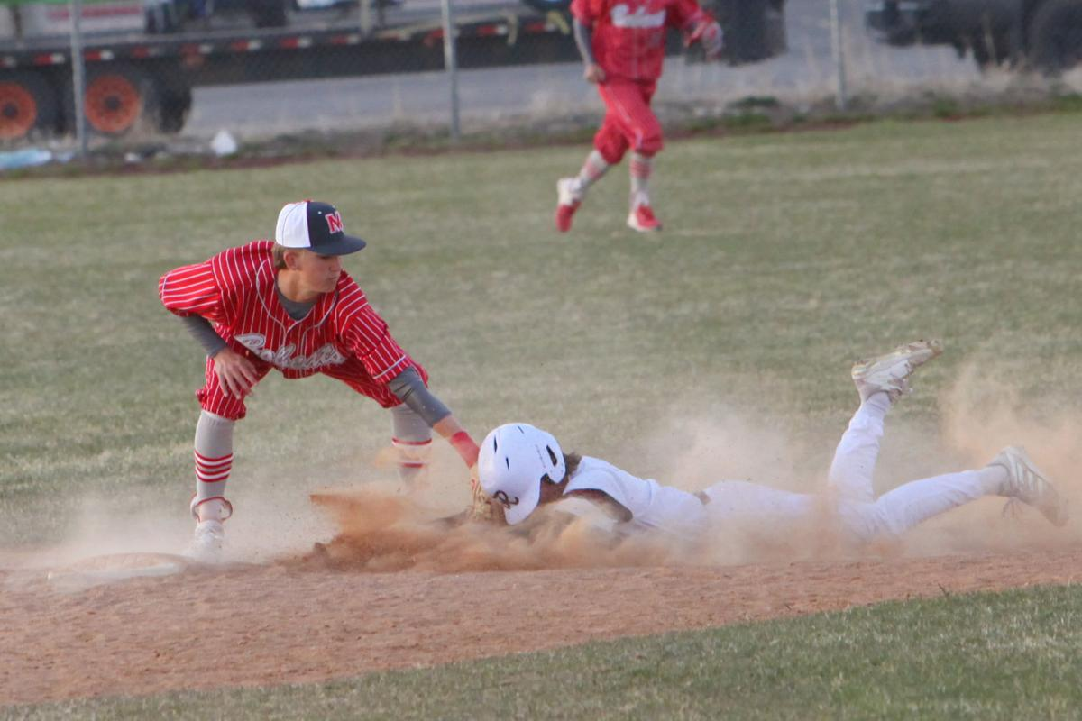 Madison's Riley Sutton tags a Rigby runner out as they attempt to slide into second base.
