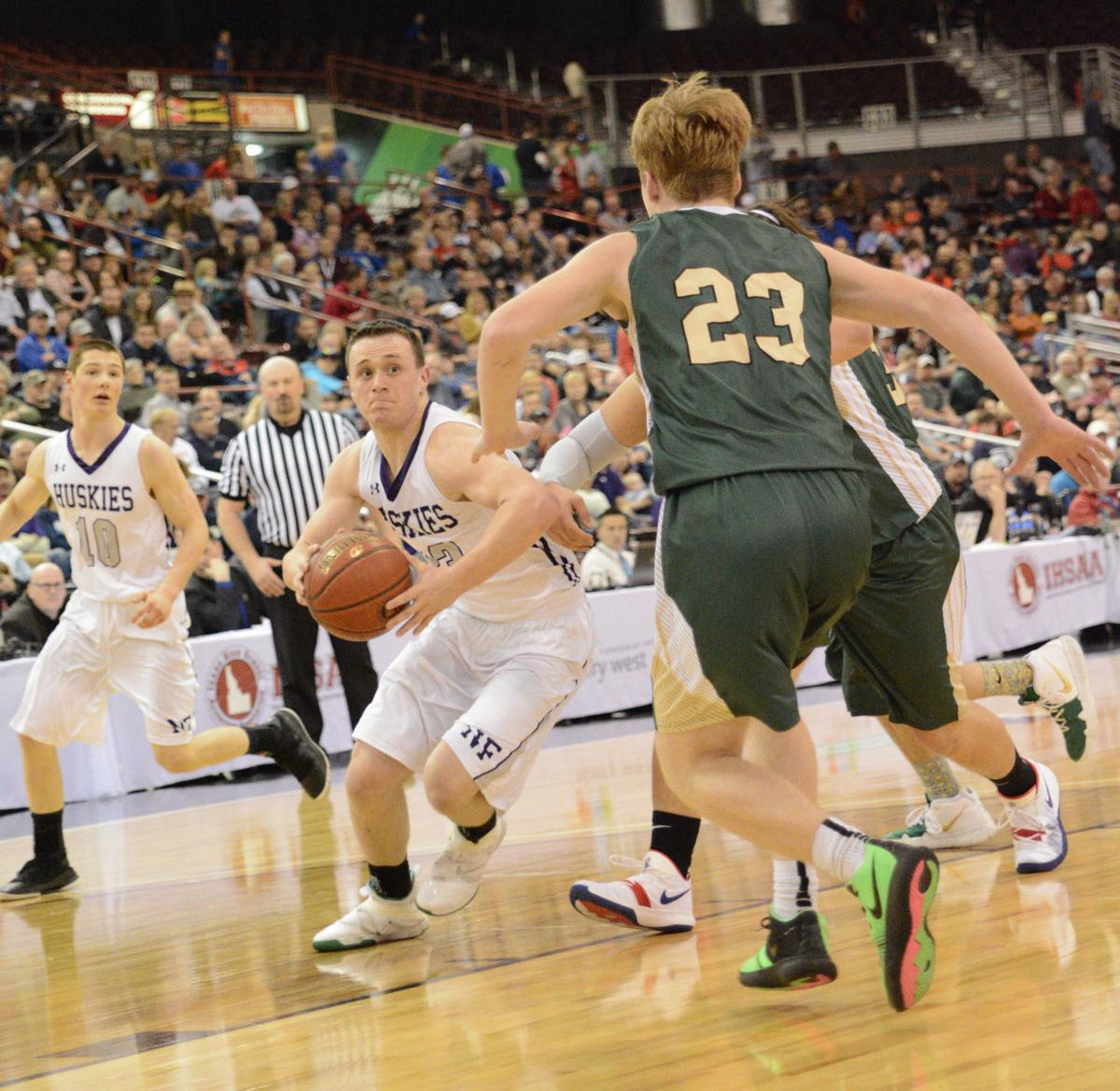 North Fremont's Paul Wynn drives to the basket in the 2A title game against St. Maries.