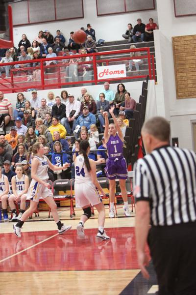 North Fremont's Graycee Litton hits a shot from the corner.