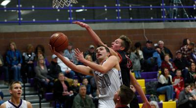 North Fremont's Luke Hill (10) takes a shot around a defender.