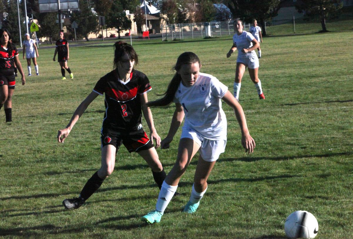 South Fremont's Payton Egbert races South Fremont's Bradyn Rigby for the ball.