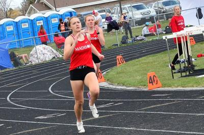 Madison's Whitney Mackenzie rounds the last turn in the 400 meters as she won the race in 1:00.16 as she continues to improve toward the goal of under a minute.