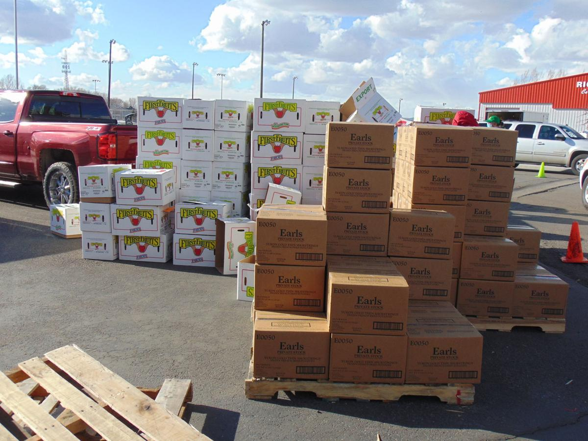 Emergency Food Distribution workers provide 500 boxes to area families