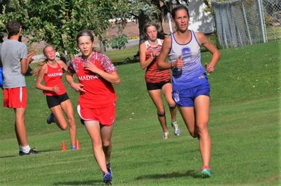 Sugar Salem's Jaresa Jackson and Madison's Rebekah Kinghorn battle for position at the Madison Quad meet.  Madison's Mikelle Dorman, who is trailing them will pass them in the last 100 meters of the race to take fifth place followed by Jackson and Kinghorn.