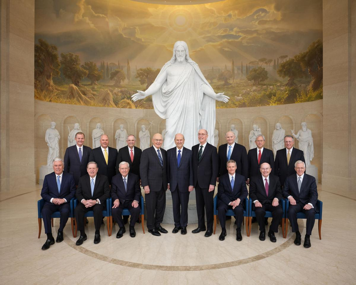 Historic photo of twelve apostles first presidency in front of Rome Temple statue