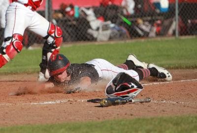 South Fremont's Jackson Coverley slides into home base.