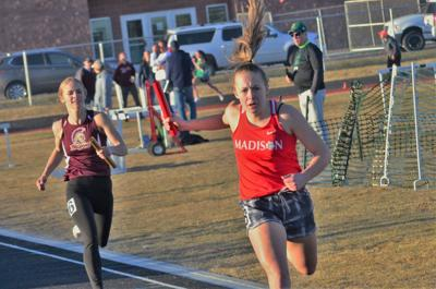 An exhausted  Whitney Mackenzie received the baton in second place and ran down the Rigby anchor runner to win the race by two seconds.  She along with Clara Thomas, Taylor Stucki and Mariah Wilson recorded the third fastest time among the 5A schools in 4:17.79 for the season so far.