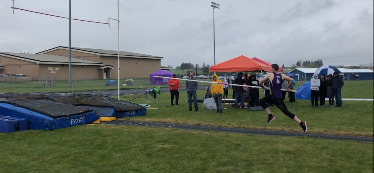 Searle sets up on the pole vault runway at a meet at Ririe last season.