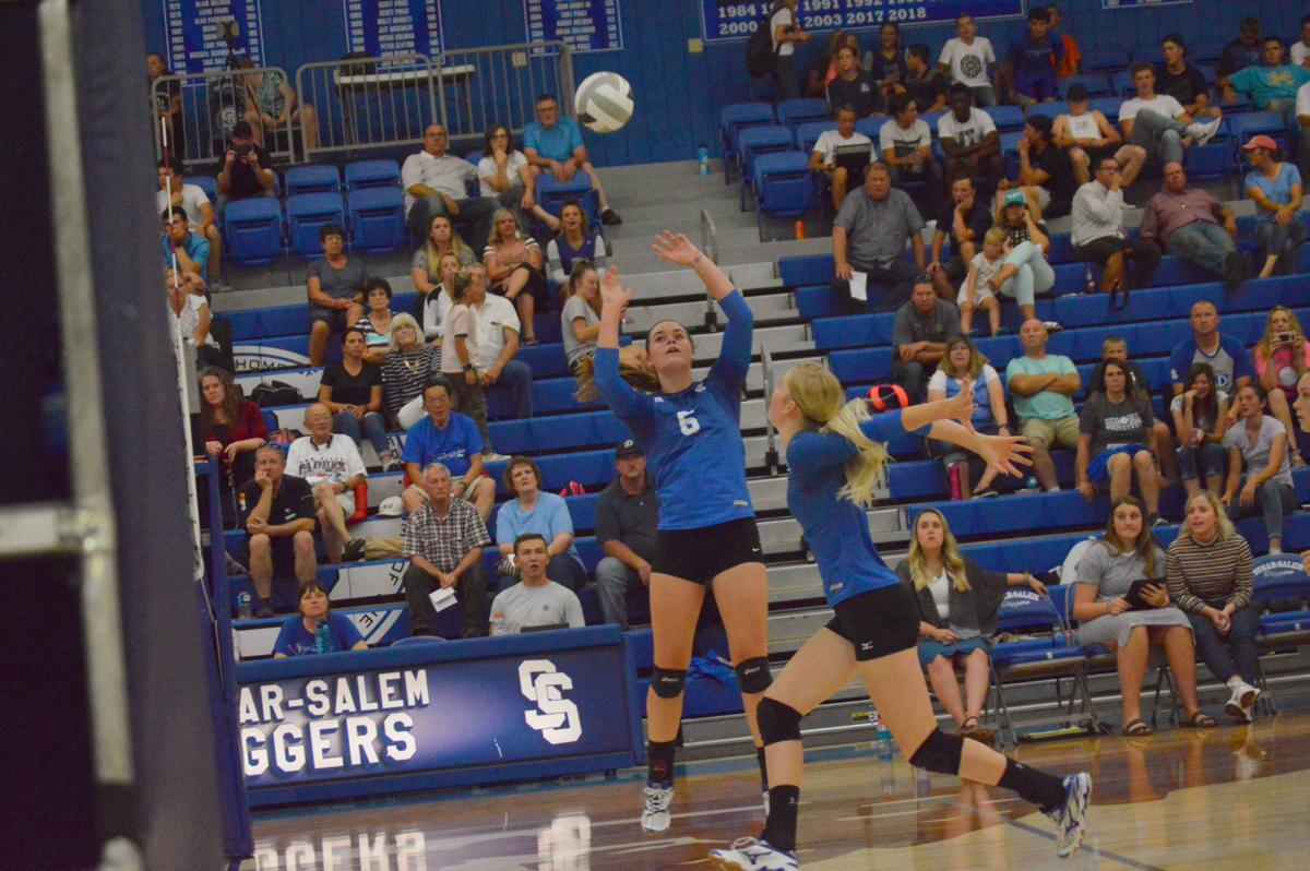 Sugar-Salem's Camber Dodson(6) sets the ball for Mardee Fillmore.