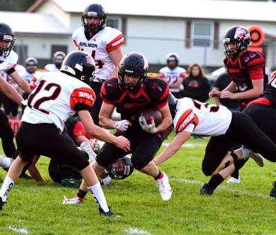 Rylan Miller runs the ball.