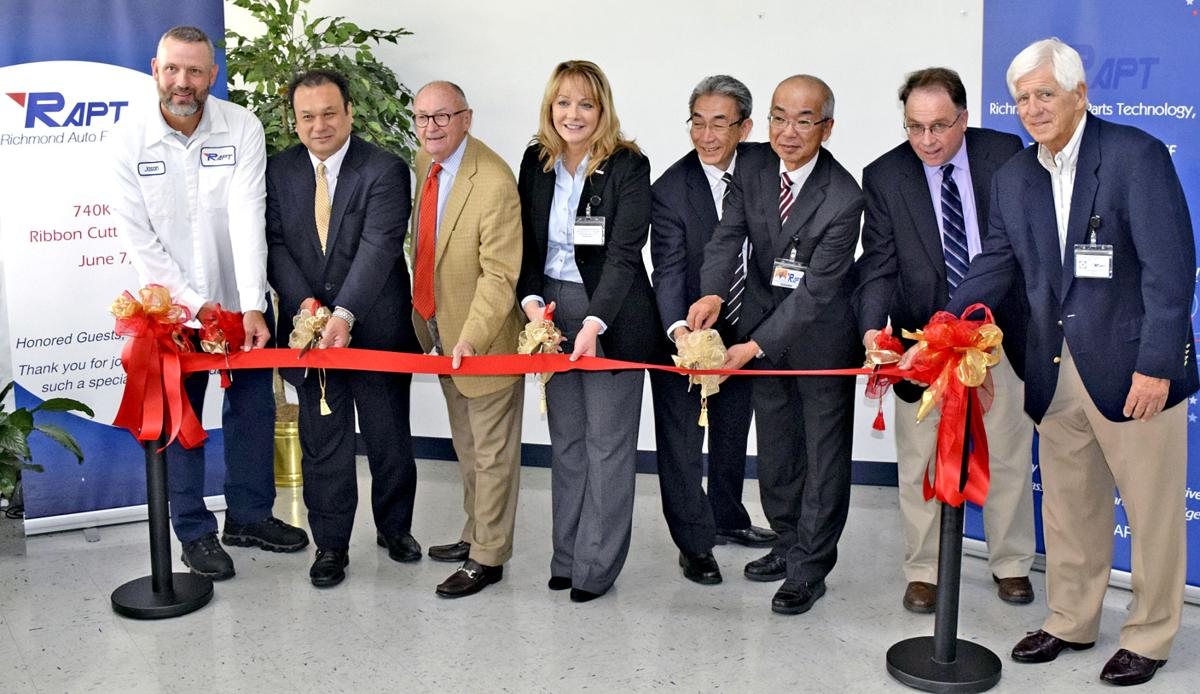 Officials from the city of richmond and toyota join richmond auto parks technology executives in a ribbon cutting ceremony to celebrate its opening of a new
