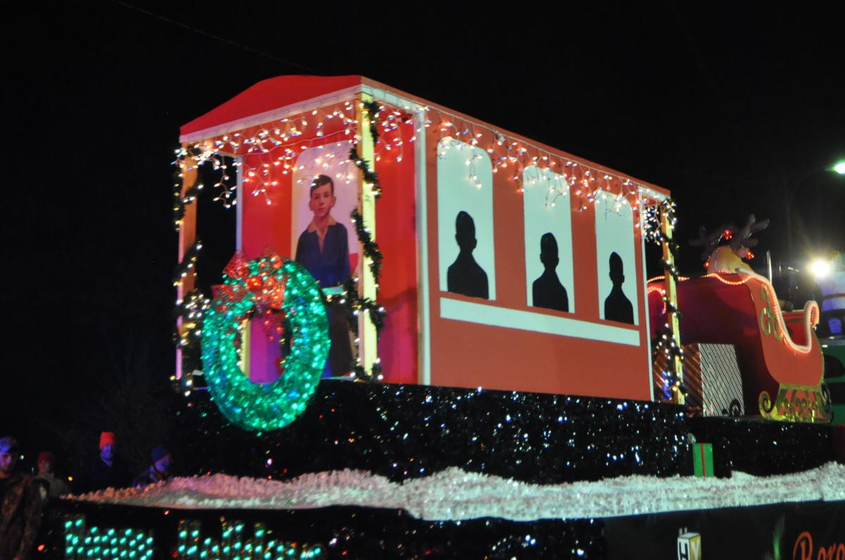an elaborate float decked out like the polar express featuring characters from the movie saturday night at bereas 31st annual twilight christmas parade - How To Decorate A Float For Christmas Parade