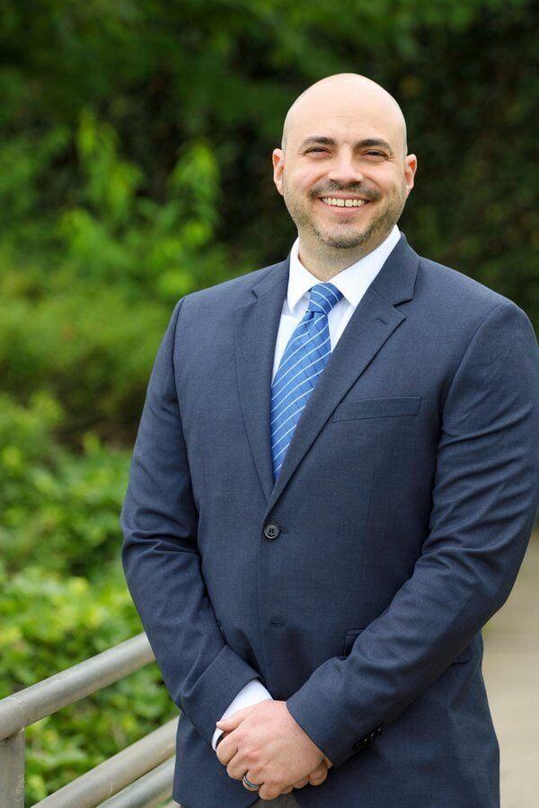 EDUCATION NOTEBOOK: Model Laboratory School names Dr. Christopher Budano interim secondary principal