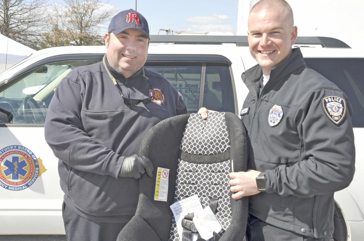 Richmond Fire Public Information Officer Corey Lewis And Daniel Kirstein Pose With A Car Seat They Will Install Thursday Afternoon During