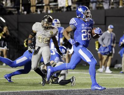 UK FOOTBALL  Snell s record-breaking night leads Kentucky to win ... d15a89092