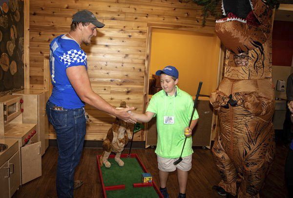 PGA golfers, UK athletes tee off with KCH patients