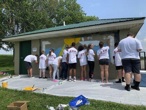 Kids paint a mural as part of RPD summer camp